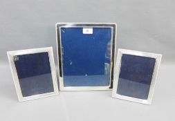 Modern silver photograph frame, Sheffield 1993, 24 x 29cm, together with a pair of smaller silver
