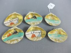 Set of six Japanese handpainted faux ivory mussel shells, with wall hanging loops, 8cm (6)