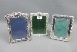 Late Victorian silver photograph frame, Birmingham 1900, 13 x 17cm together with two later