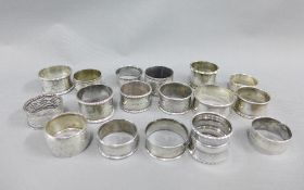 A collection of seventeen napkin rings to include thirteen British silver hallmarked examples, one