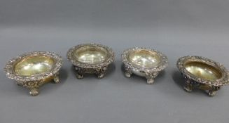 Set of four 19th century silver plate on copper salts, two with circular clear glass liners, on