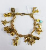 9ct gold charm bracelet complete with fourteen charms to include 11 gold and three unmarked