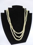 Cultured pearl triple strand necklace with silver clasp, stamped 925