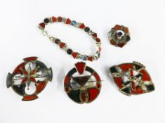 A collection of Scottish hardstone, silver and white metal jewellery to include four brooches and