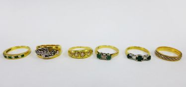 A collection of six 18ct gold rings to include a five stone diamond ring, three emerald and
