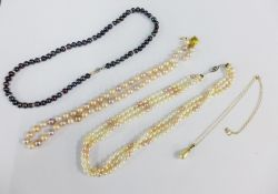 A strand of cultured pearls with a 9ct gold clasp, two strands of faux pearls with a silver clasps