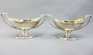 A pair of George III silver gilt salts, John Emes, London 1804, of twin handled navette shape, on