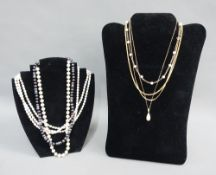 Two 9ct gold chains, 9ct gold chain with pearls, a strand of cultured pearls with a 9ct gold