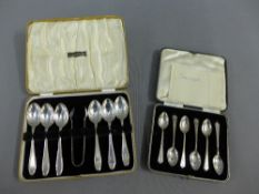 Two cased sets of silver teaspoons with sugar tongs (a lot)