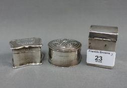 Three small silver boxes to include a circular box. London 1900, Art Nouveau box, Birmingham 1902