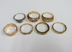 A collection of six 9ct gold rings and another unmarked yellow metal ring (7)