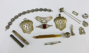 Early 20th century silver and white metal items to include a buckle, hair slide, brooches, bracelet,