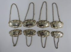 A set of seven 19th century Scottish silver decanter labels, James Howden & Co and George Paton,