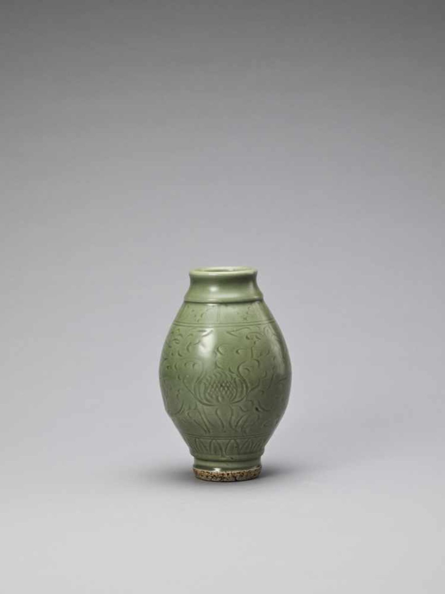 Los 408 - A CARVED LONGQUAN CELADON 'LOTUS' JAR, YUAN TO EARLY MING <br