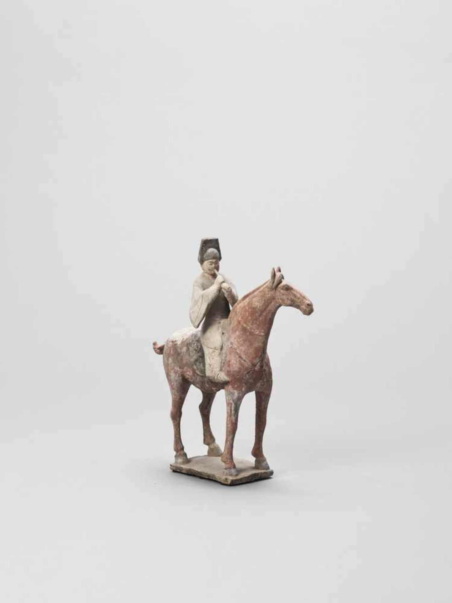 Los 389 - A COLD-PAINTED TERRACOTTA MODEL OF A HORSE AND RIDER, TANG