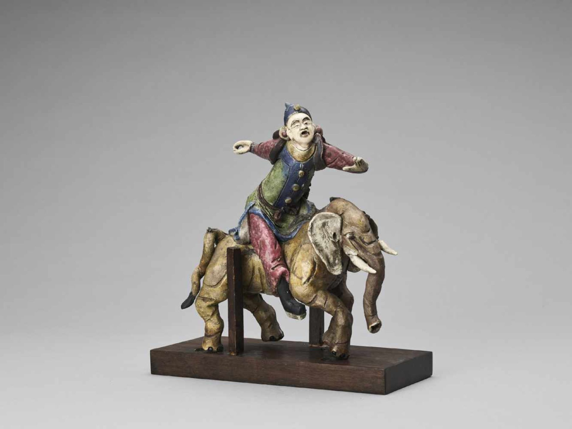 Los 395 - A GLAZED TERRACOTTA FIGURE OF A DIGNITARY RIDING AN ELEPHANT, MID-QING