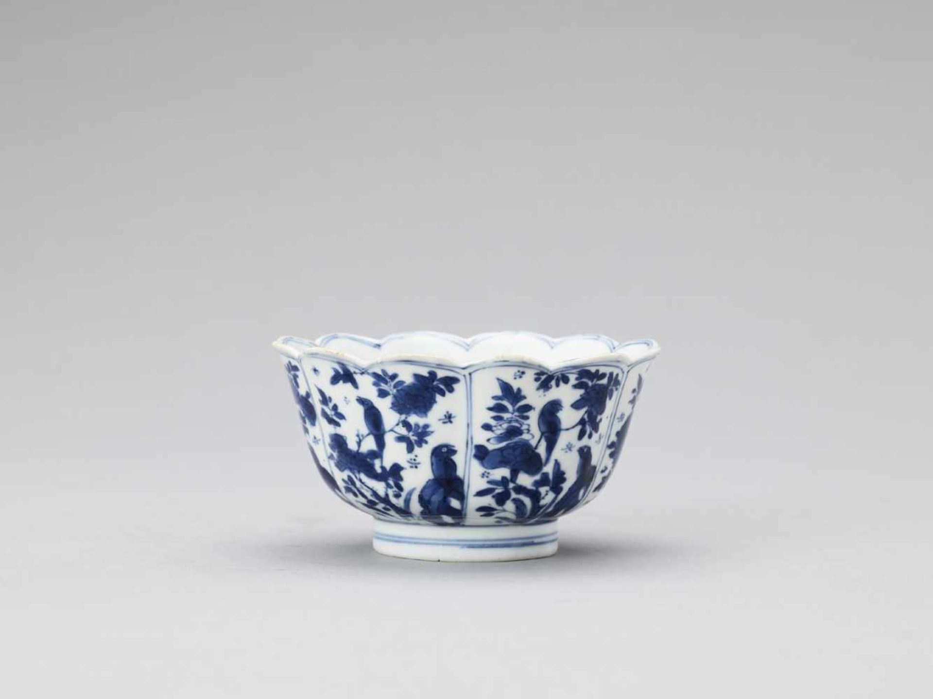 Los 443 - A BLUE AND WHITE LOBED BOWL, KANGXI