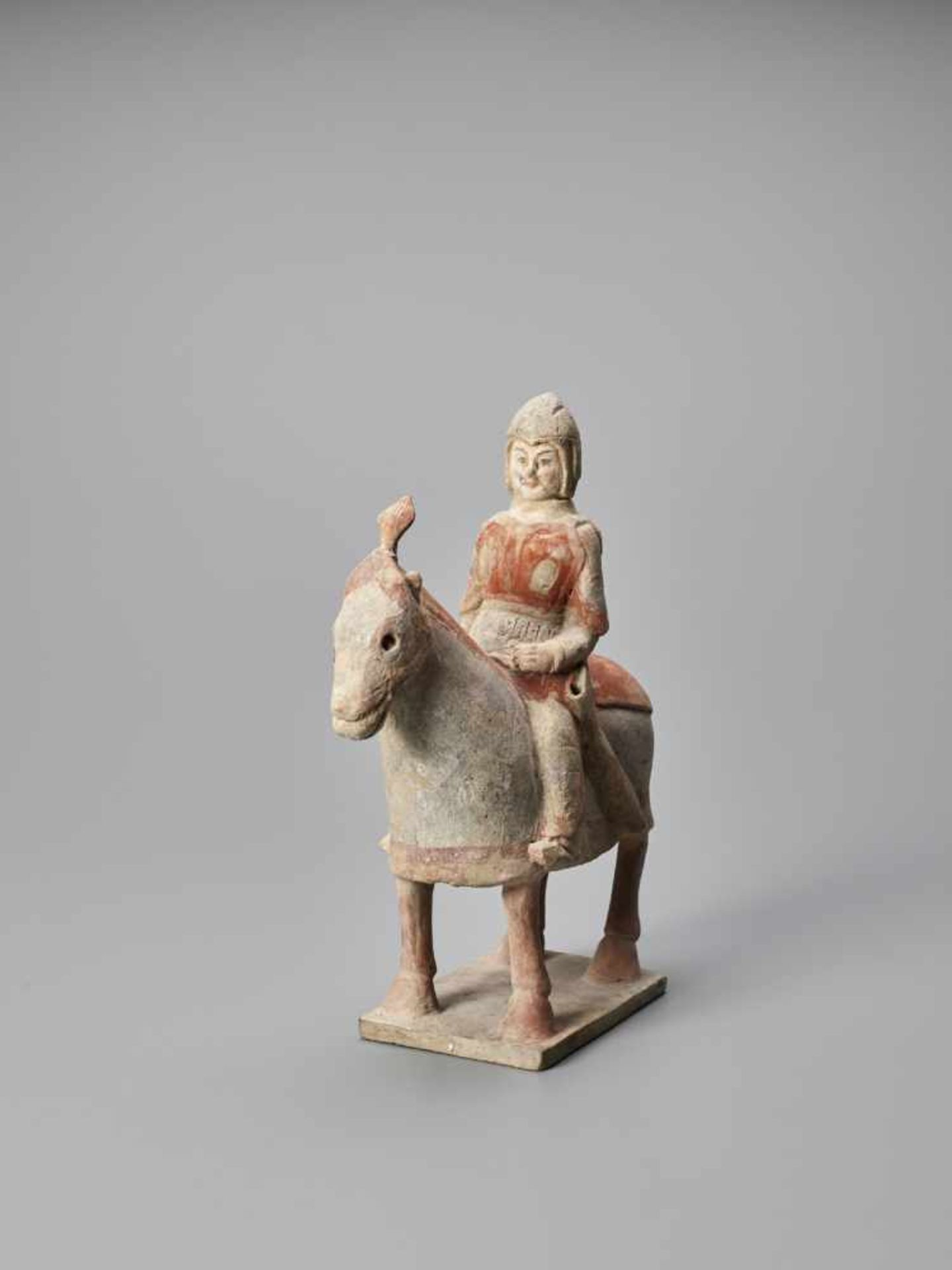 Los 391 - A TERRACOTTA FIGURE OF A HORSE AND RIDER, NORTHERN WEI