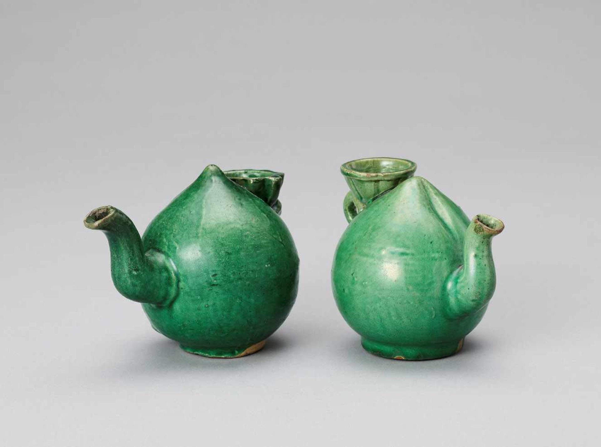 Los 428 - A PAIR OF EMERALD GREEN GLAZED POTTERY PEACH FORM WATER DROPPERS, KANGXI