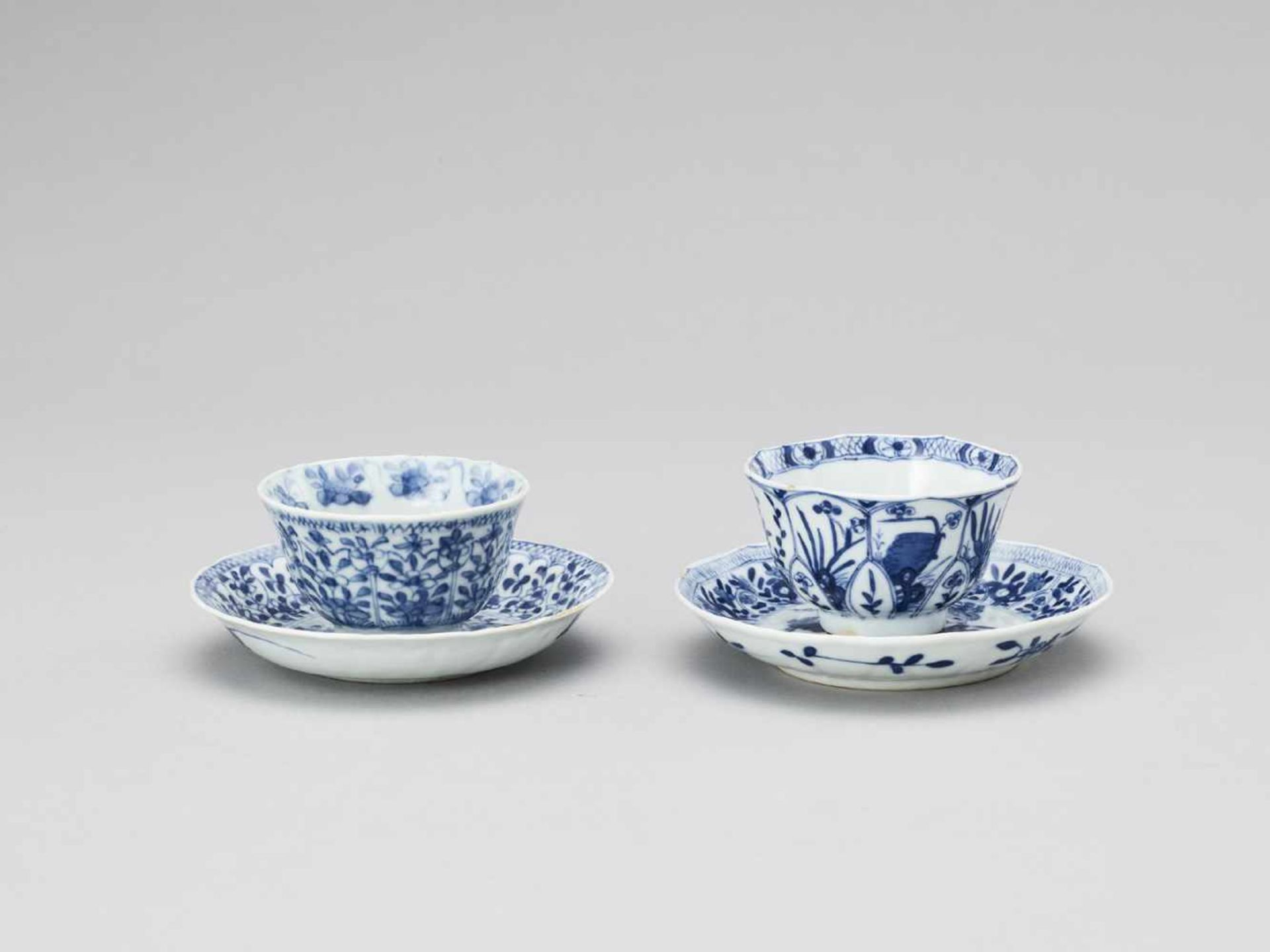 Los 419 - A PAIR OF BLUE AND WHITE PORCELAIN CUPS WITH MATCHING PLATES, KANGXI