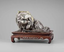 MARUKI COMPANY: AN EXCEPTIONAL AND LARGE PARCEL-GILT AND SILVERED OKIMONO OF A CHIN DOG By the