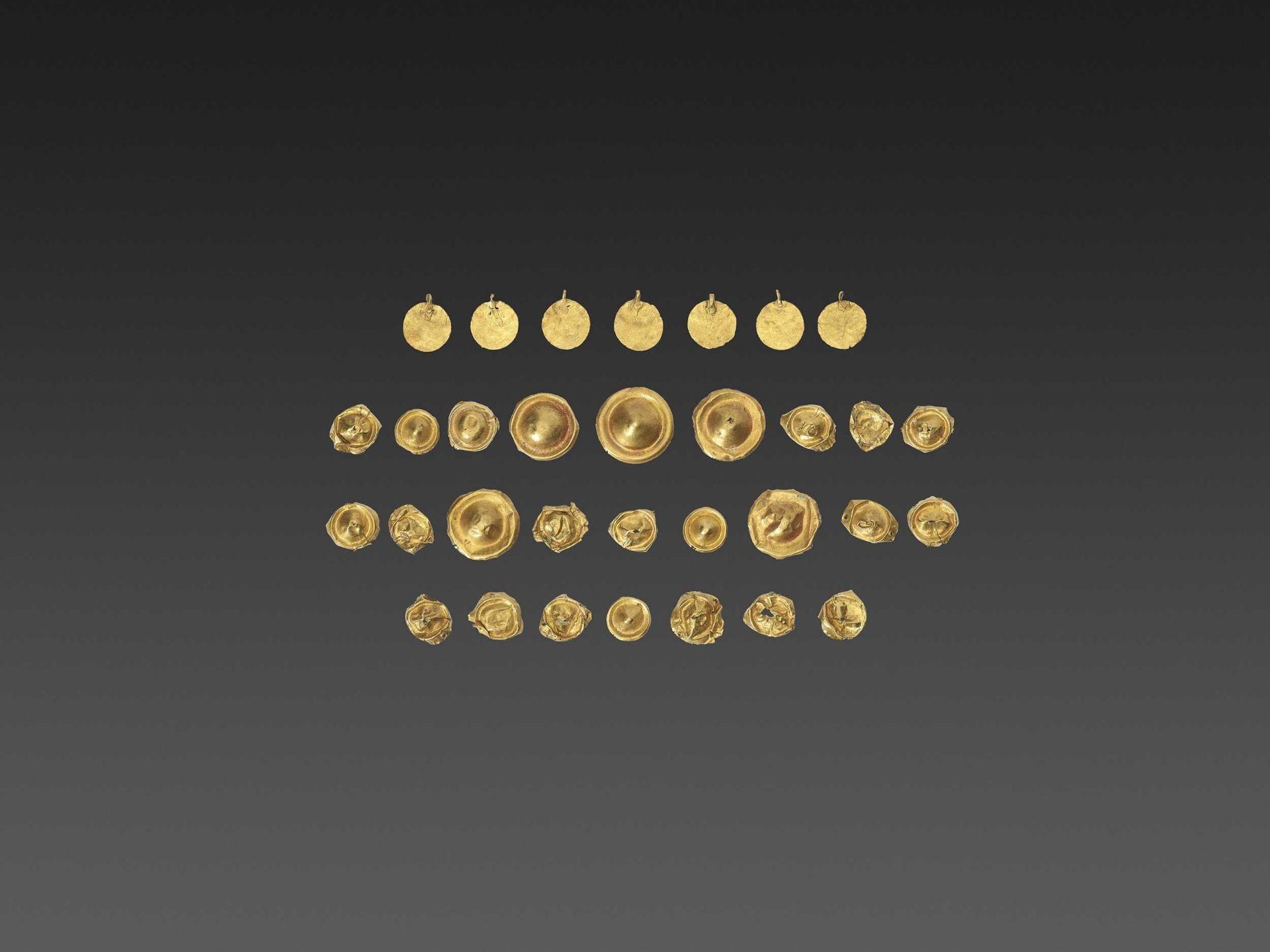 32 BACTRIAN GOLD GARM ENT ORNAMENTS
