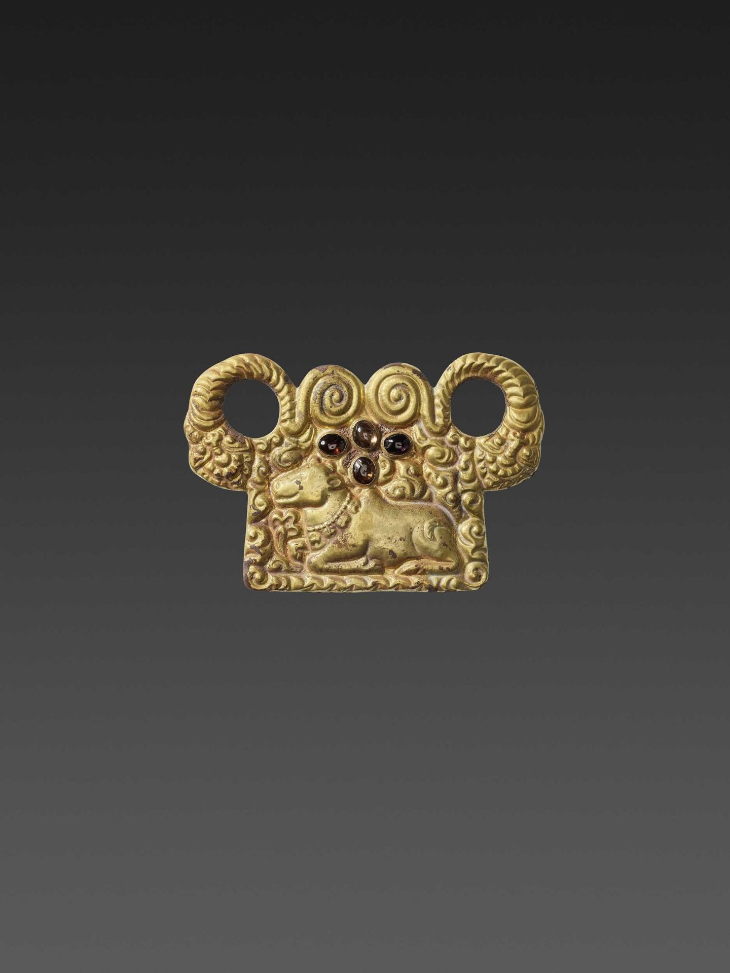 A CHAM ZIRCON AND AMETHYST-SET GOLD REPOUSSÉ PECTORAL DEPICTING NANDI AND NAGAS