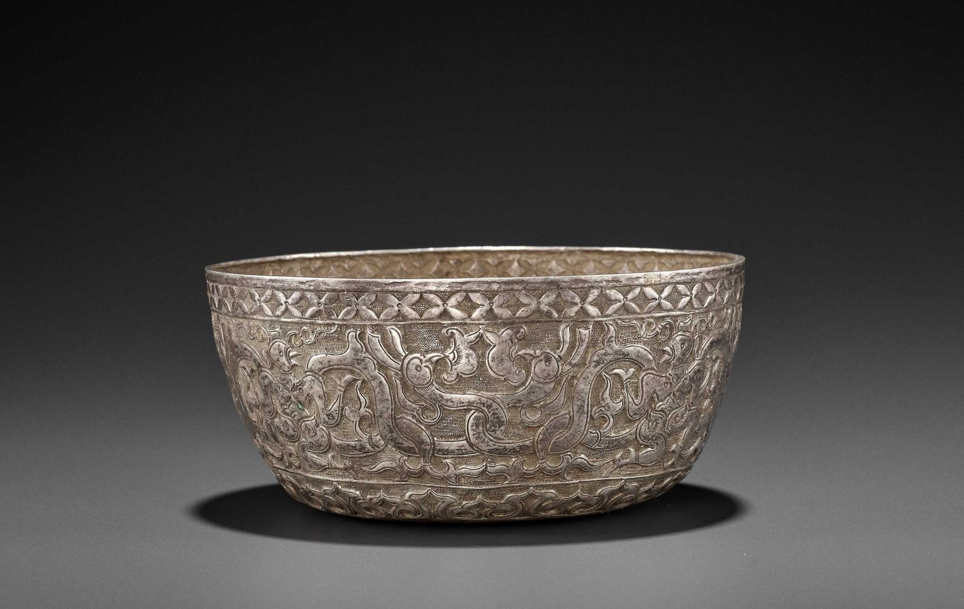 A VERY RARE AND FINE CHAM SILVER REPOUSSÉ BOWL WITH GARUDAS AND PHOENIXES