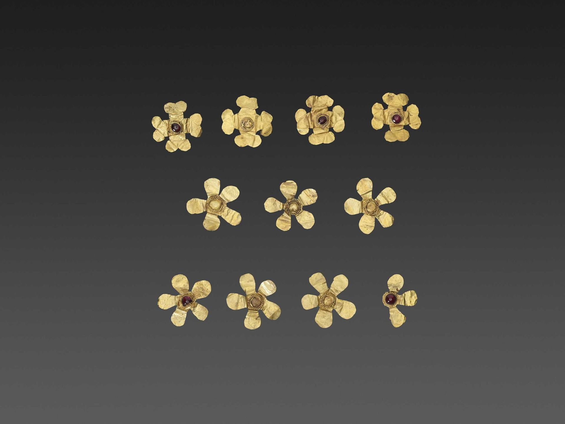 11 BACTRIAN GOLD 'FLOWER' GARMENT ORNAMENTS