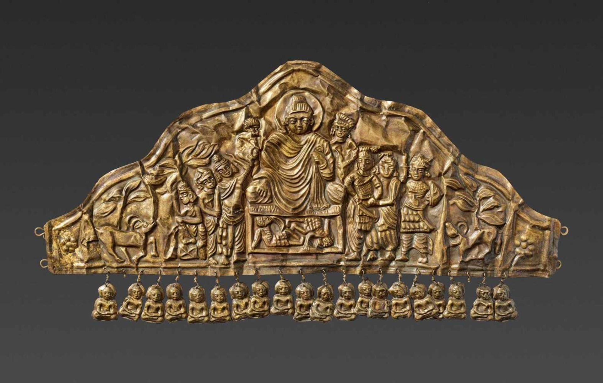 AN EXTREMELY RARE GANDHARAN GOLD DIADEM DEPICTING BUDDHA DEFYING MARA