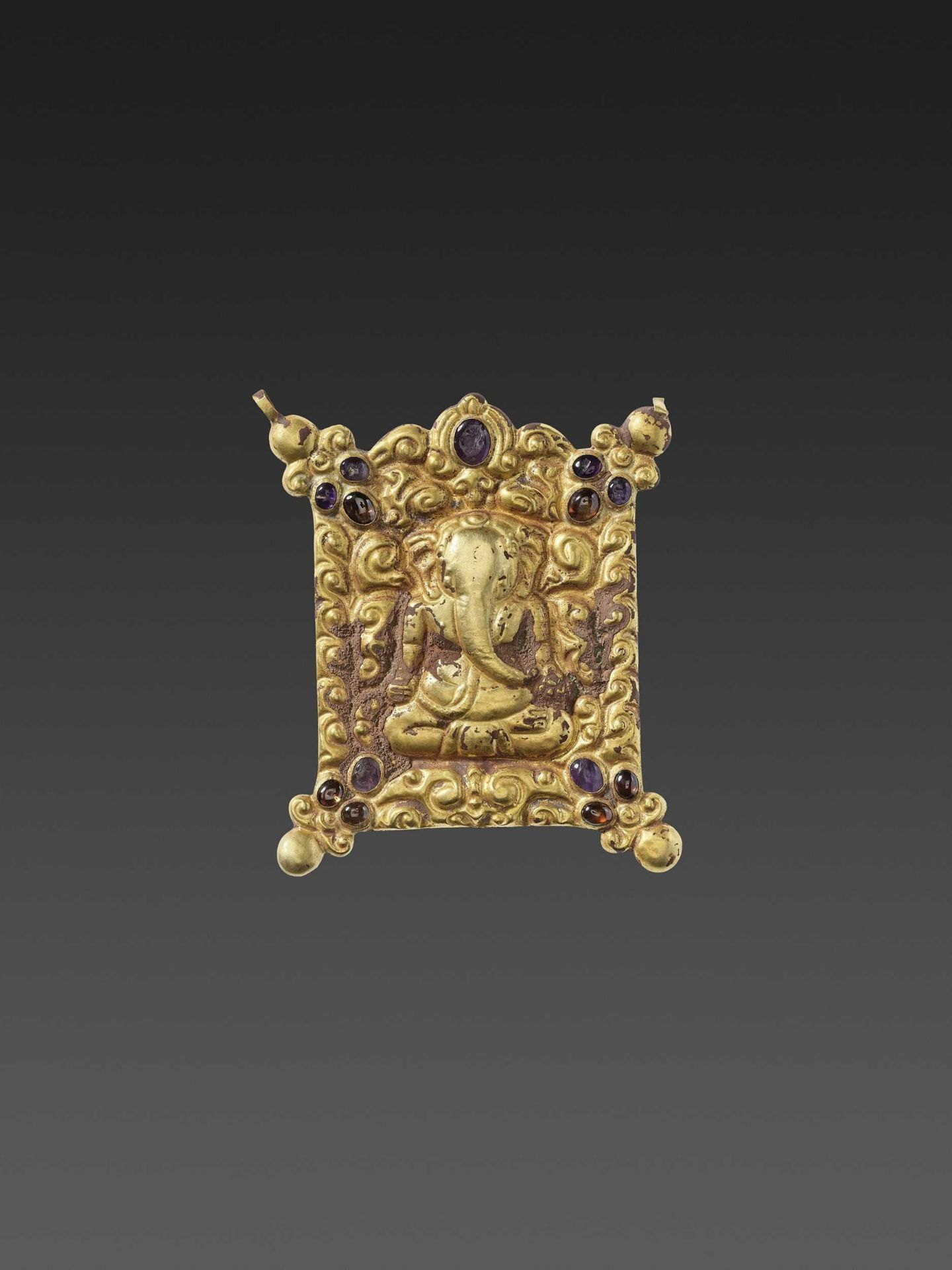 A CHAM GEMSTONE-SET GOLD REPOUSSÉ PECTORAL DEPICTING GANESHA MEDITATING