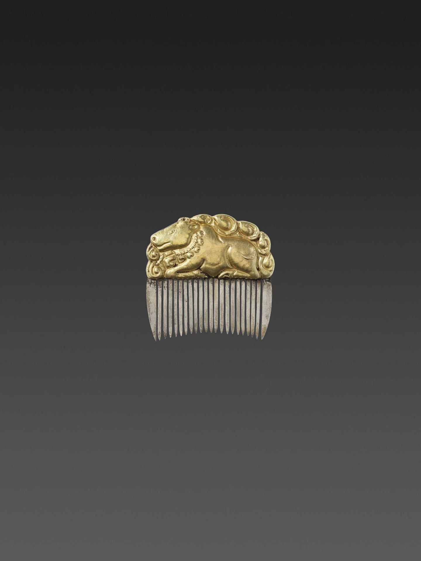 A CHAM GOLD REPOUSSÉ AND SILVER HAIR COMB WITH NANDI
