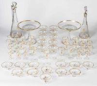 Extensive crystal service MOSER-KARLSBAD, Model Royal, 1907 or shortly after, diamondcut, crystal   Umfangreiches Kristallservice MOSER-KARLSBAD Modell Royal, 1907 oder kurz danach, Diamantschliff, Kristallglas, vergoldeter Rand, mit Monogramm Höhe: 4,3 bis 43 cm  Bestehend aus: 2 Wein-Karaffen (38 und 43 cm hoch), 2 grossen Dessert-Schalen (Durchmesser: 25,5 cm, Höhe: 22 cm), 10 Champagner-Schalen (Durchmesser: 10 cm, Höhe: 12,5 cm), 11 Wasser-Gläser (10 cm hoch), 11 Likör-Gläser (11 cm h...