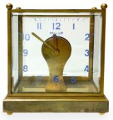 Table clock with brass structure and bevelled glass, switzerland production 60s. Electric movement