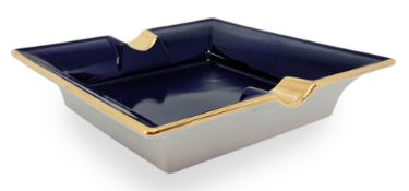 Richard Ginori porcelain ashtrays in dark blue tones, with gold details. Years 80. Cm 18x18x3