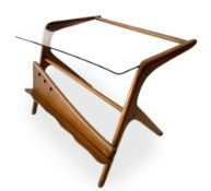 Italian Production, light wood coffee table glass top and magazine rack. Years 50. 46x60x50 cm.