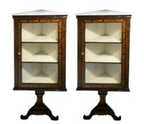 Pair of corner cupboards in rosewood with marquetry and Perfili light wood, white marble floor, the