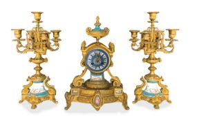 Triptych consisting of watch and pair of candlesticks to 5 lights with porcelain inserts in the