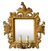 Mirror in gilded wood with two candles. 18th/19th century. Sculpted and engraved with crowned