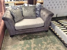 GREY SADDLE & BISCUIT FABRIC SNUG CHAIR (DAMAGE TO