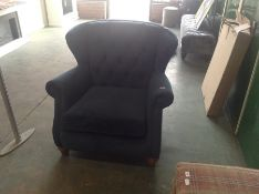 BLUE BUTTON BACK WING CHAIR RIPPED ON SEAM OF ARMS