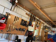 Quantity of Various Tools & Supplies Affixed to Wall to inc. Tape, Knives, Clamps, Spanners, Mole
