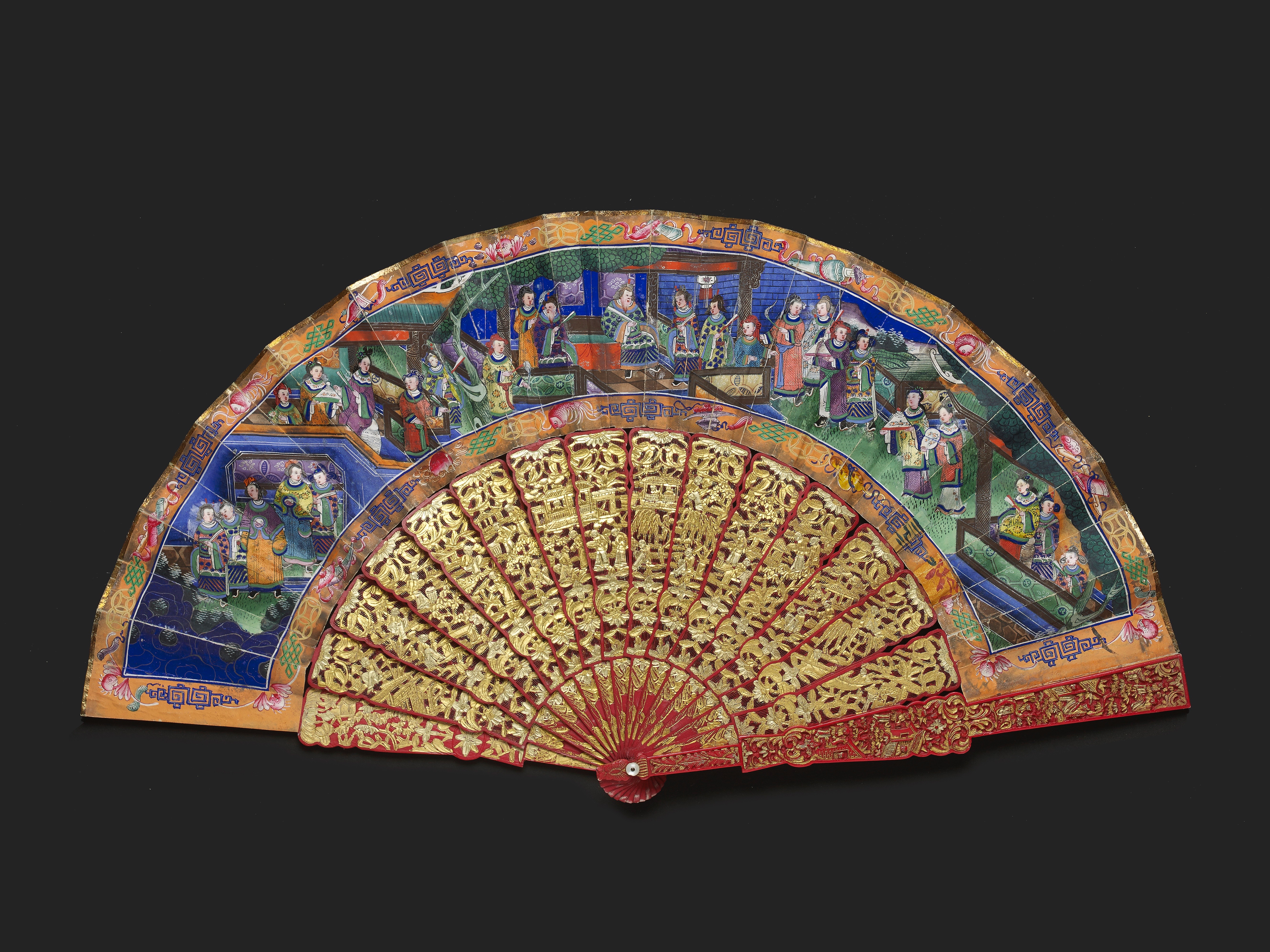 Lot 15 - A CHINESE EXPORT RED STAINED IVORY MANDARIN FAN, QING DYNASTY, DAOGUANG PERIOD, CIRCA 1840
