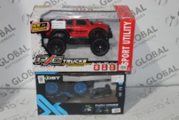Boxed Assorted Children's Remote Control Trucks to Include Fury Cross Flipping Remote Control and
