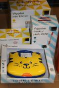 Assorted Children's Toy Items To Include My First Laptop, Alphabet Floor Puzzle, Woode Cake Stand,