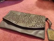 Ladies everyday use clutch bag in brown with bronze studs.