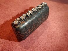 Tinted leopard print black and silver finish clutch bag.