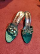Women's emerald green shoes, size 5/6 comes in bag with extra stones.