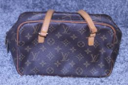 RRP £1400 Louis Vuitton Cite Shoulder Bag In Brown Coated Monogram Canvas. Condition Rating B (