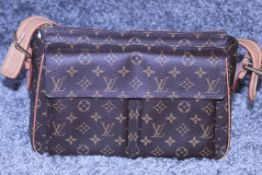 RRP £1700 Louis Vuitton Viva Cite Handbag In Brown Coated Monogram Canvas. Condition Rating A (
